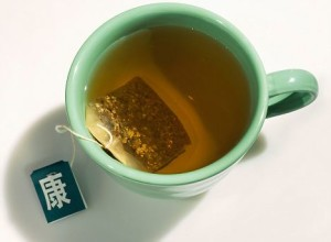 Cup of Green Tea with Tea Bag on a White Background. Image shot 2007. Exact date unknown.